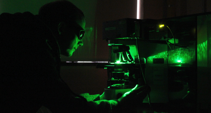 Graduate student Jeremy Campbell displays the live micron scope