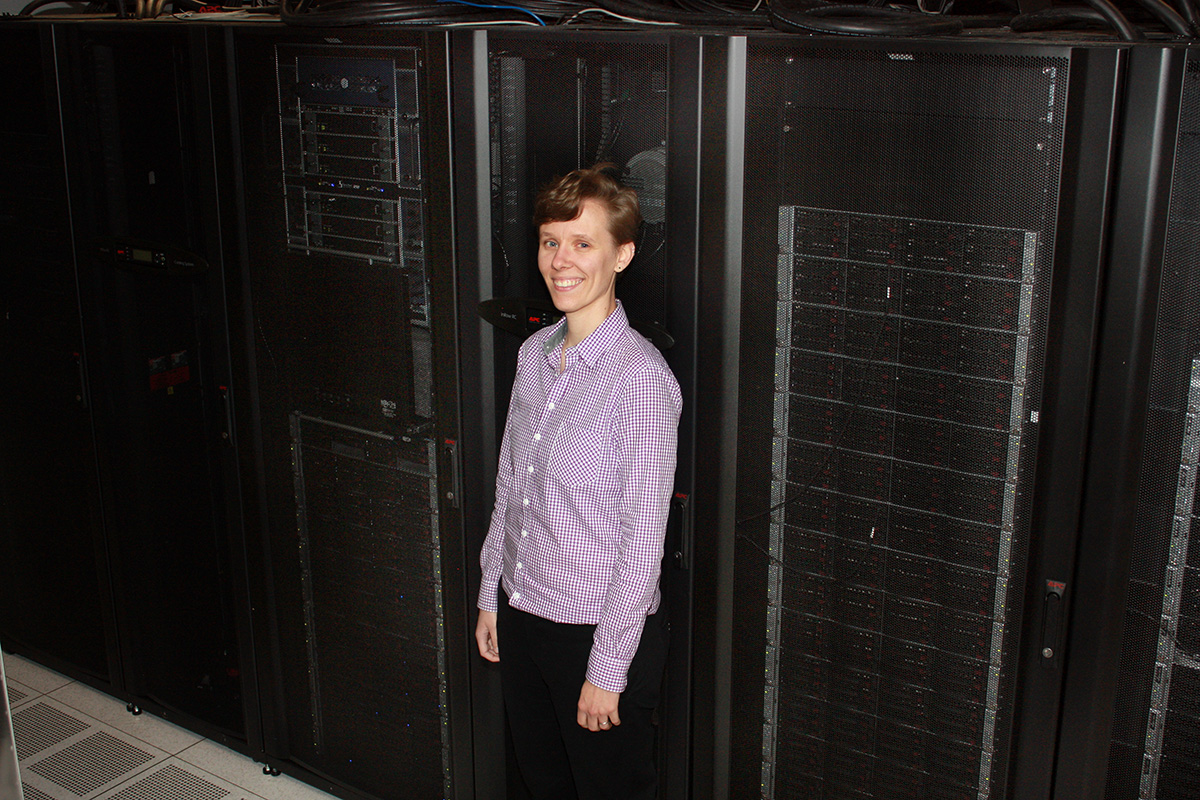Lynza Sprowl with the supercomputer at Argonne National Lab.