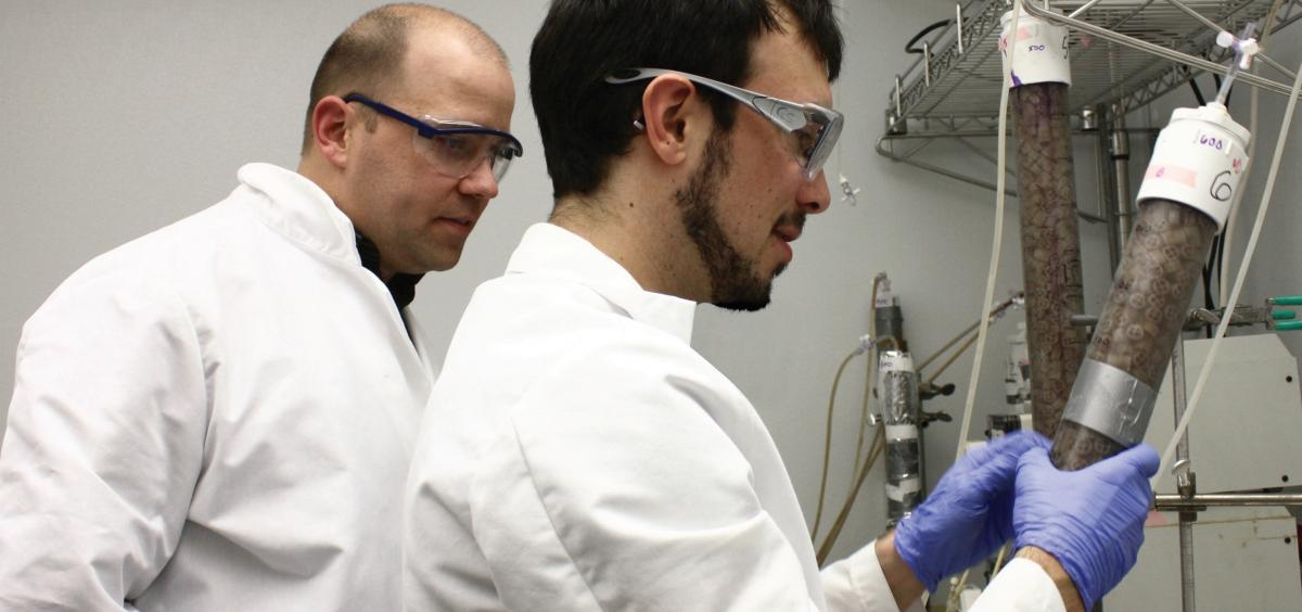 Tyler Radniecki and a graduate student working in the laboratory.