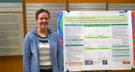Student Eileen Lukens with her Johnson Internship research poster