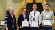 Professor Dorthe Wildenschild, left, presents award certificates to Lynza Sprowl, Riley Murnane, and Ross Warner, selected as the top three poster presenters at the College of Engineering's 2018 Graduate Research Showcase.